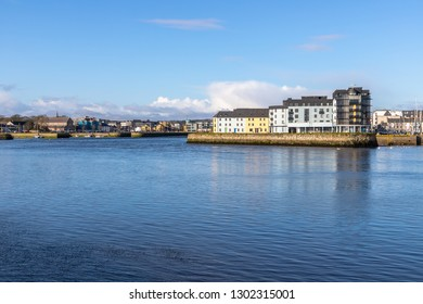 Corrib river and city buildings with reflection, Galway, Ireland