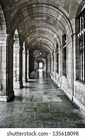 corridor with arches and stone columns outside the cathedral