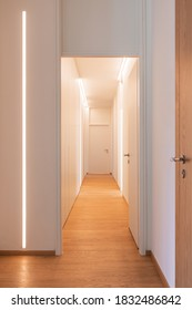 Corridor detail with door and led strip. Minimal apartment. Nobody inside. Concept