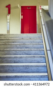 corridor with doctor waiting on a staircase and front lift red in hospital