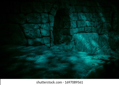 The corridor is horror, scary, darkness. Ghostly gloomy cave in the castle, alcove in the tunnel, entrance to the basement in the mystical night light of the moon with eerie strange shadows