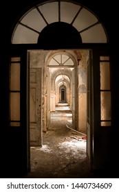 Corridor inside of abandoned hospital built in 19th century.