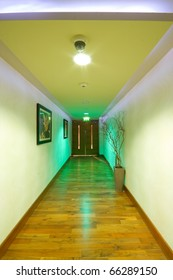 Corridor interior with wooden floor and pictures on the wall