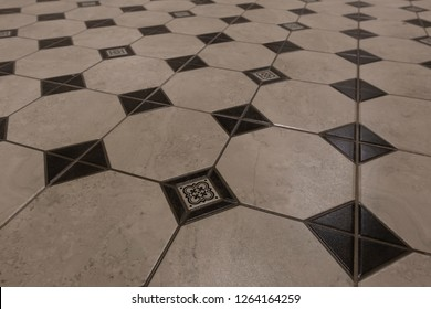 Corridor or kitchen flooring: the tiles have a rhombus texture of brown and beige colors
