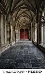 The corridor leading to the door.