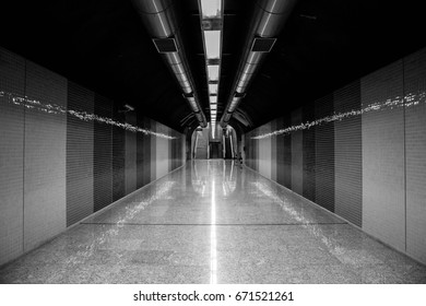 Corridor leading to a subway./ Hall./ Hall of a subway.
