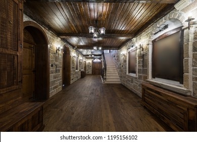 Corridor in mansion with stone walls and wooden doors
