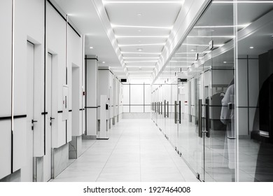 corridor of a modern corporation in high-tech style. the exterior of the shopping center in light colors.