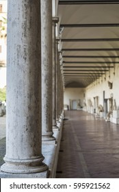 Corridor of roman columns as background in Rome, Italy