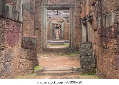 Corridor of Stone Walls and pillars to a Wood Door in Siem Reap Angkor Wat Temple Cambodia Asia