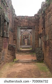 Corridor of Stone Walls to a Wood Door in Siem Reap Angkor Wat Temple Cambodia Asia
