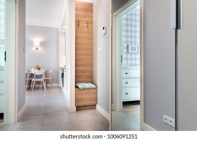 Corridor with tiled floor in modern apartment