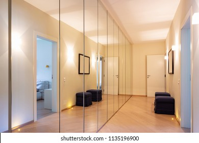 Corridor with wardrobes and mirrors. Nobody inside