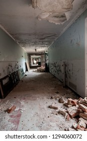 Corridors and rubble from demolition at a derelict lunatic asylum, Severalls, Colchester, Essex, England, UK