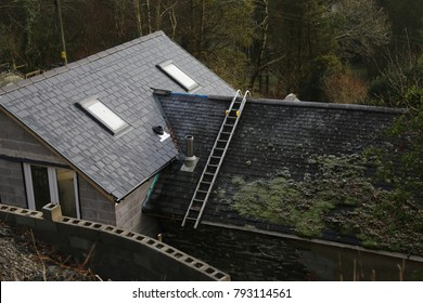Corris, Gwynedd, Wales, UK.  12 January 2018.  A view looking down on a house extension with a mossy roof and roof ladder.