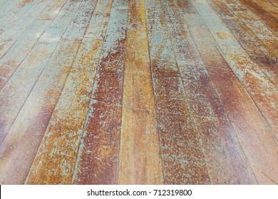 Corroded and damaged seasoned wooden floor plank with scratch marks needs restoration