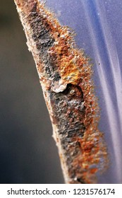 Corroding rear wheel arch of a ten year old crossover
