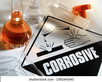 Corrosive Warning Sign - A corrosive substance is one that will damage or destroy other substances with which it comes into contact by means of a chemical reaction.
