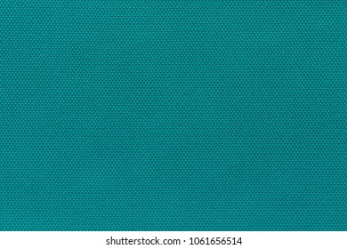 corrugated background and abstract wattled texture of fabric or textile material of turquoise color
