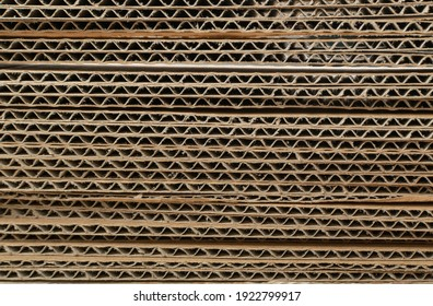 Corrugated Cardboard Edge Layers Textured Background. Carton Cut Slices Pattern with Copy Space, Ripped Kraft Paper Wallpaper, Brown Wrapping Vintage Paper Top View