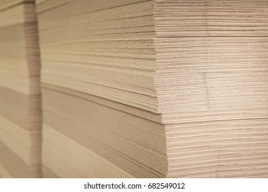 Corrugated cardboard in the factory close-up side view.