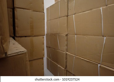 Corrugated Cardboard storage boxes stacked in warehouse of small factory