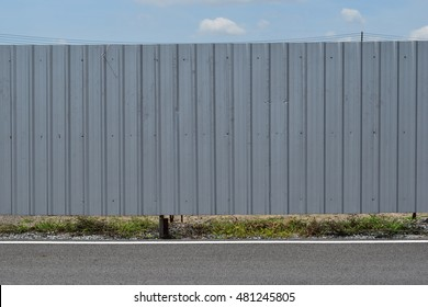 corrugated fence of silver metal sheets texture