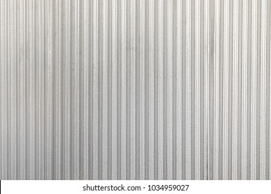 The corrugated grey metal wall background. Rusty zinc grunge texture and background.