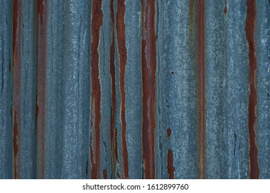 corrugated iron pattern with a few pieces of rust