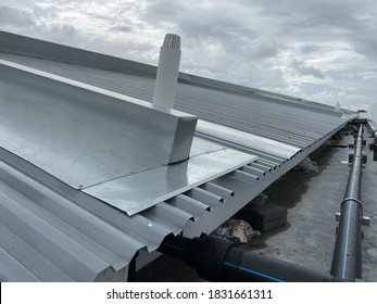 corrugated metal deck roof system with galvanised iron sheets installed on a building
