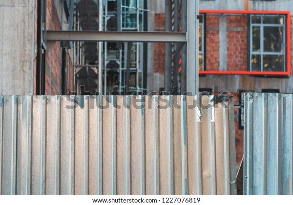 Corrugated Metal Fence On Construction Site Stock Photo