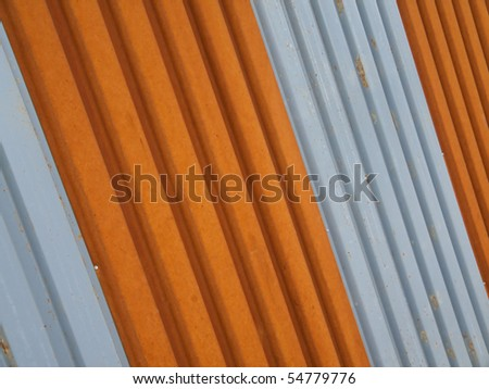 Corrugated Metal Fence Painted Orange Silver Stock Photo
