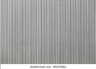 Corrugated metal roof picture taken from above, industrial background or texture.