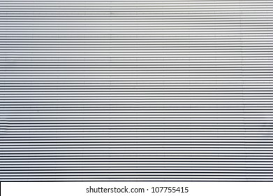 The corrugated metal sheet texture.