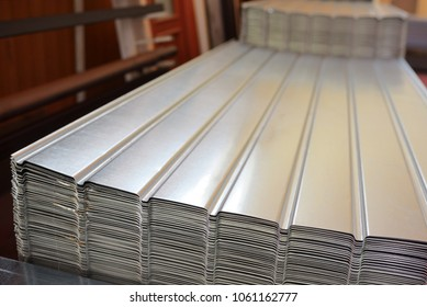 Corrugated metal siding fence in warehouse