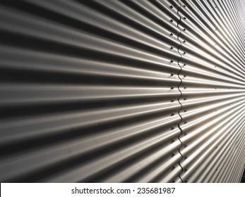 corrugated metal warehouse facade abstract