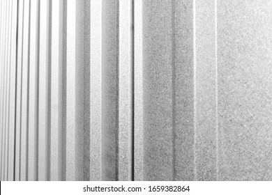 Corrugated metal, zinc texture surface, galvanize steel in the vertical line texture in black and white toning.