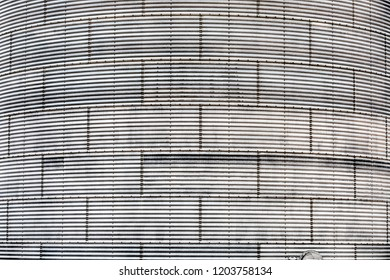 The corrugated steel exterior of a grain silo in Eastern Washington is a curved background with texture.
