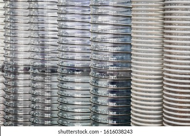 corrugated transparent plastic pipe with metal frame background