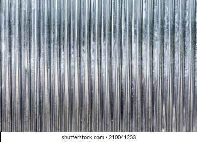 Corrugated zinc metal texture may be used as background.