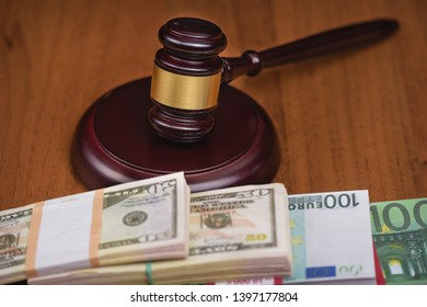 Corrupt court. Judge's gavel and bundles of money on the judge's table.Trial of money scammers.
