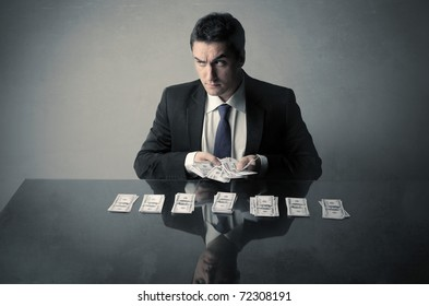 Corrupted businessman counting out some banknotes