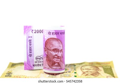 Corruption clampdown of Indian government with new series of Indian Rupee currency,money isolated on white background ready for business and investment,Focus on eye of gandhi on roll banknotes