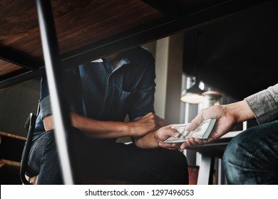 corruption concept, Male keeping money and deal from Contact person to company his for business lobbyist.