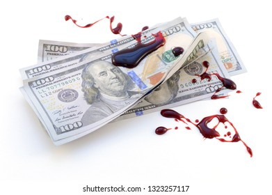 Corruption concept with the use of American hundred dollar bills soaked in dripping fresh red blood.