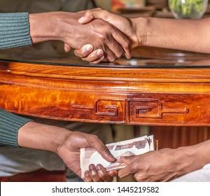 Corruption, receiving bride under bthe table under the table.