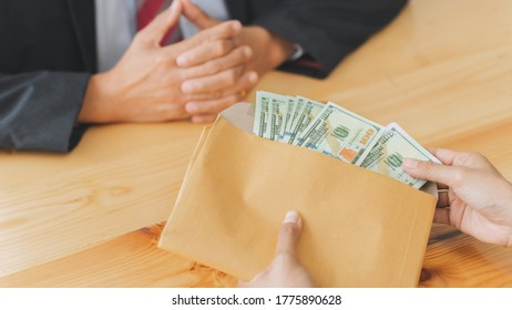 Corruption and venality concept, Businesspeople giving a bribe money.