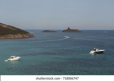 Corsica, 28/08/2017: speedboats in the Mediterranean Sea on the Cap Corse with view of the nature reserve of les Iles Finocchiarola, the three little island named A Terra, Mezzana and Finocchiarola