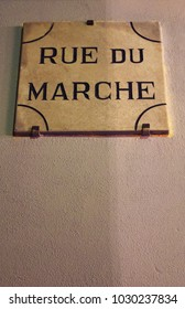 Corsica: the sign of Rue du marche (Market Street) in the old Citadel of Bastia, the city in the northeast at the base of the Cap Corse