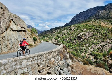 Corsica-cyclist on the way along the river Golo
